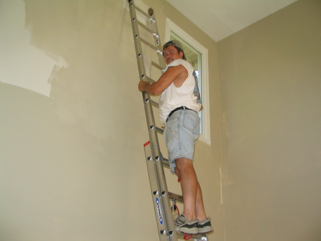 painting tall interior wall