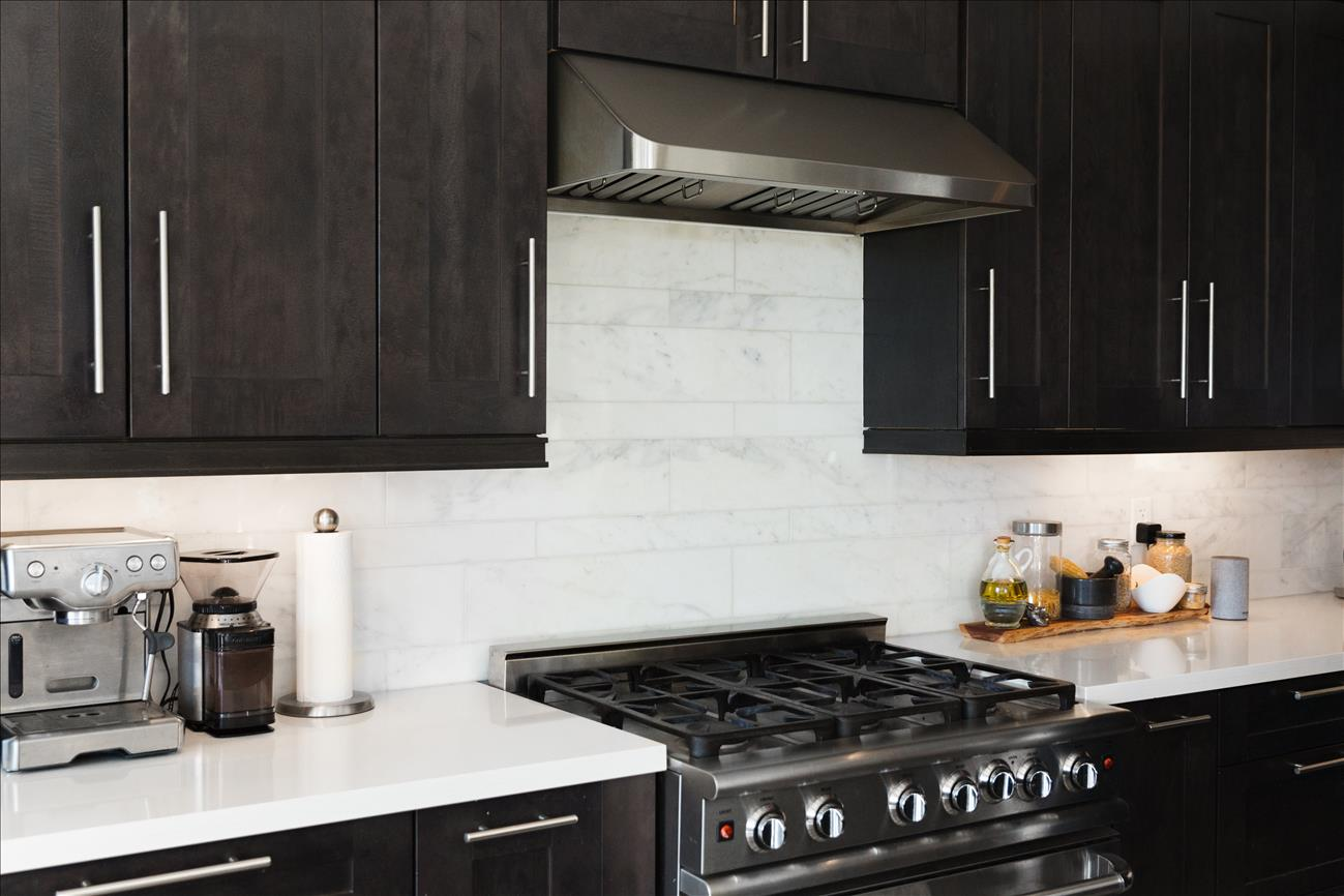 remodeled upscale kitchen gas range