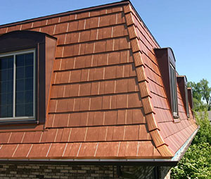 can you install metal roof over wet shingles